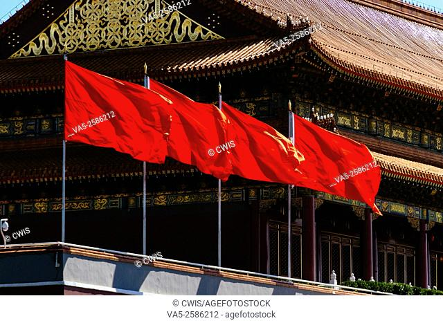 Beijing, China - Close up of the red flags on the Tiananmen Tower in the daytime
