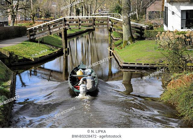 motorboat on canal, Netherlands, Overijssel, Giethoorn