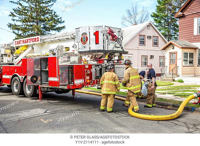 Firemen in front of a house