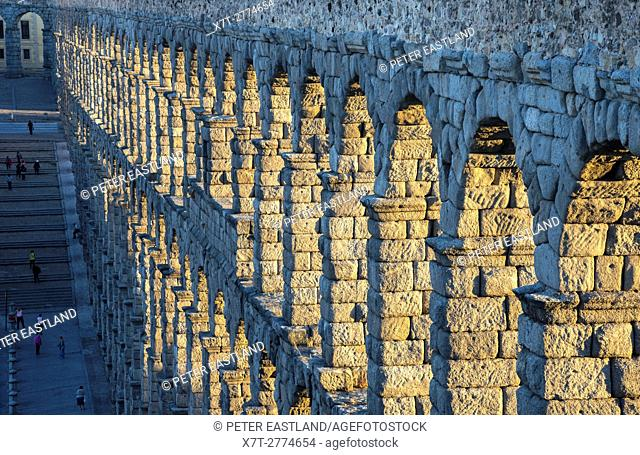 Looking along Segovia's 1st century Roman Aqueduct in the Plaza Azuguejo, Segovia, Spain