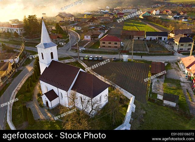 Aerial view of a small village with old church in Transylvania, Romania