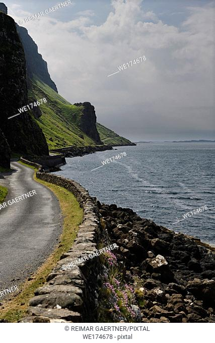 Steep cliffs and rock wall of Highway B8035 on the shore of Loch Na Keal on the Isle of Mull Scotland UK