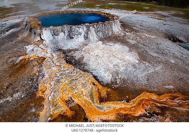 Punchbowl spring produces vivid colors from bacteria in the Upper geyser Basin near Old Faithful at Yellowstone National Park, Wyoming
