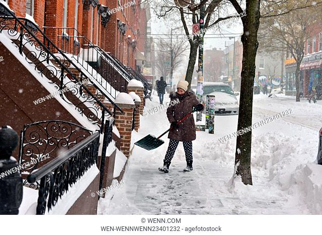 Heavy snow continues to fall as New Yorkers in Williamsburg, Brooklyn try to go about there every day business or attempt to enjoy the snow