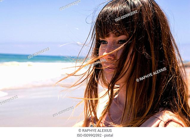 Young woman by the sea
