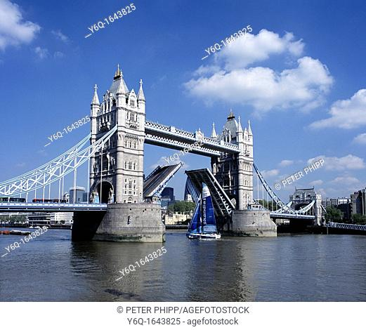 Tower Bridge in London opens to allow a tall yacht to pass through
