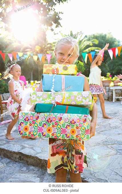 Girl with stack of birthday presents