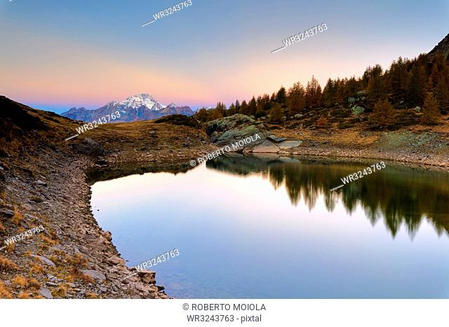 Autumnal sunrise on Monte Disgrazia and Lakes of Campagneda, Valmalenco, Valtellina, Sondrio province, Lombardy, Italy, Europe