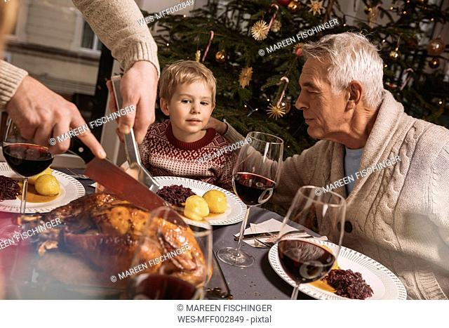 Family Christmas dinner with turkey