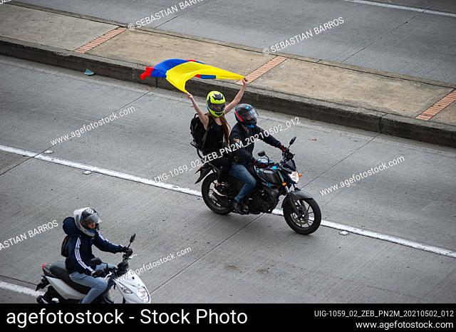 Bikers with Colombian Flags, flood streets of Bogota to celebrate the withdraw of the tax reform of President Ivan Duque, in Bogota, Colombia on May 2, 2021