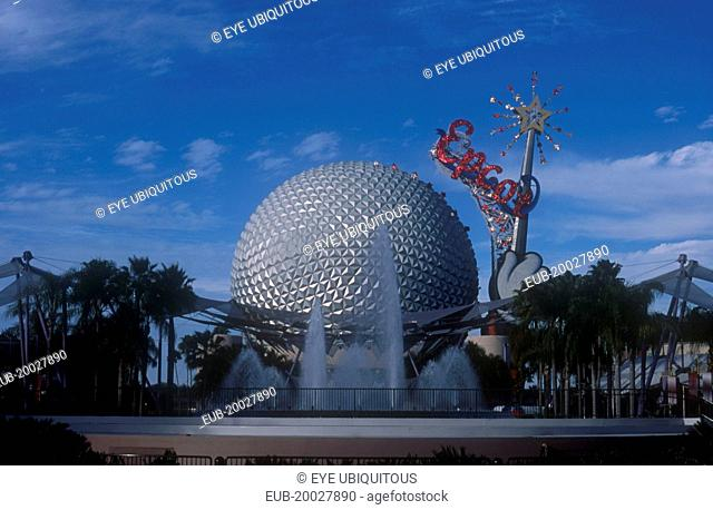 Walt Disney World Epcot. View of the Spaceship Earth with sparkling red Epcot sign and fountain at the base