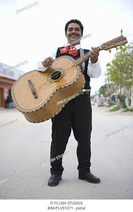Mariachi player with guitar