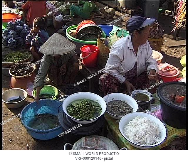 Fuit and vegetable stalls at traditional market. Laos