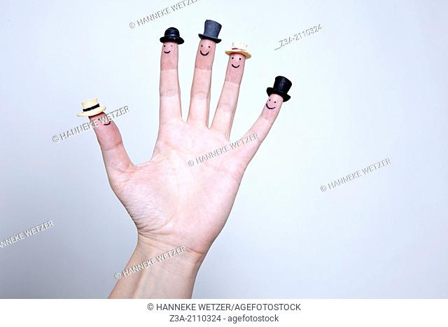Hand With Smileys And Hats On Fingers, Hand Gesture, Studio shot