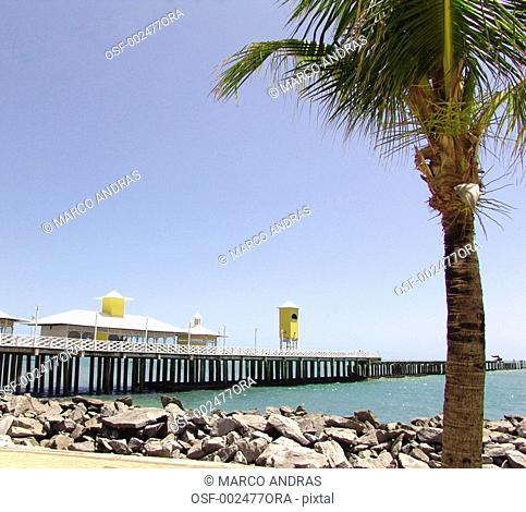 fortaleza pier in the sea with many rocks