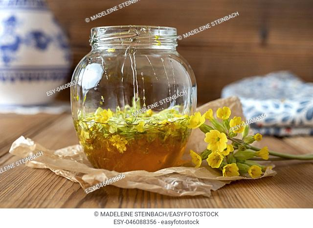 Preparation of a homemade herbal syrup from fresh primula flowers and honey