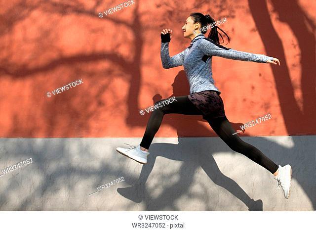 Young women running outdoors