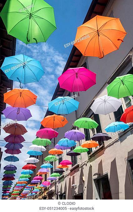 Pietrasanta, Lucca, Tuscany, Italy: the main street with colorful umbrellas