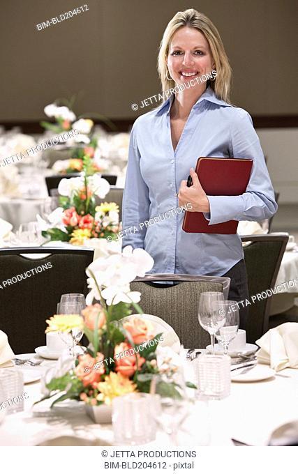 Caucasian businesswoman smiling in dining room
