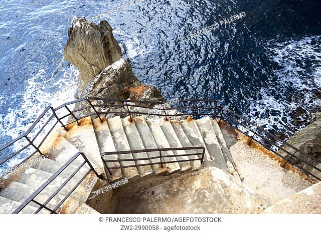 The incredible staircase of Neptuno cave in the morning. Alghero, Sardinia. Italy