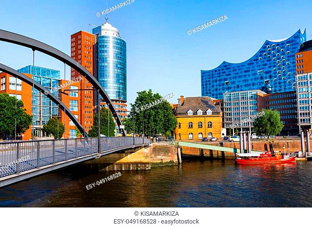 City of Warehouses or Speicherstadt district, Niederbaumbridge bridge and Kehrwiederspitze in Hamburg city, Germany