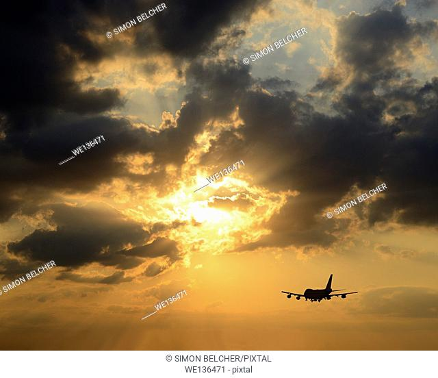 Airplane Silhouetted Against a Sunset