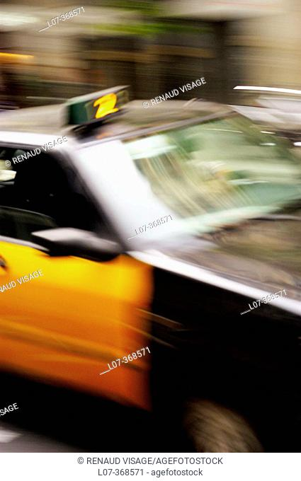 Taxi cab in motion. Barcelona, Spain