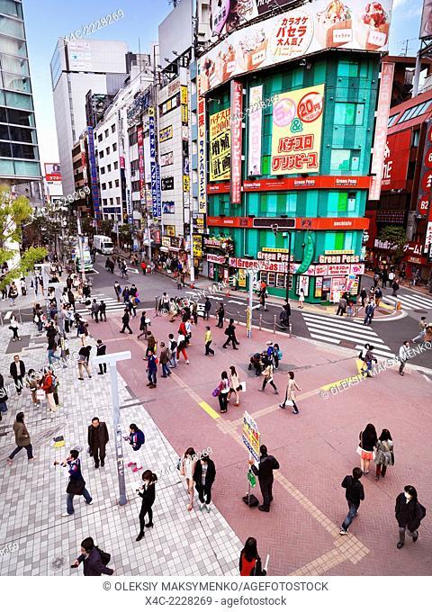 People on a plaza at Shinjuku JR station South exit in Shinjuku, Tokyo, Japan 2014