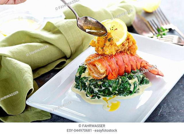 Fried lobster tail with cremy spinach and lemon
