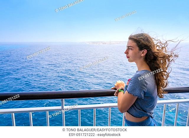 Girl in boat railing at Formentera Ibiza islands of Spain