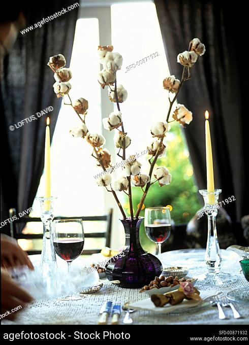 Elegantly laid table with red wine