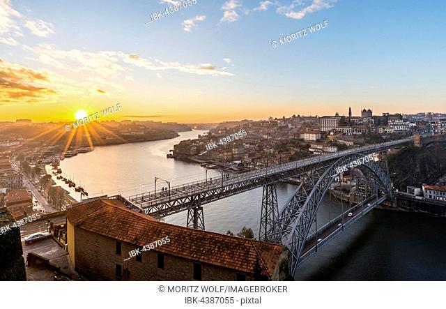 View over Porto with Dom Luís I Bridge across River Douro, sunset, Porto, Portugal