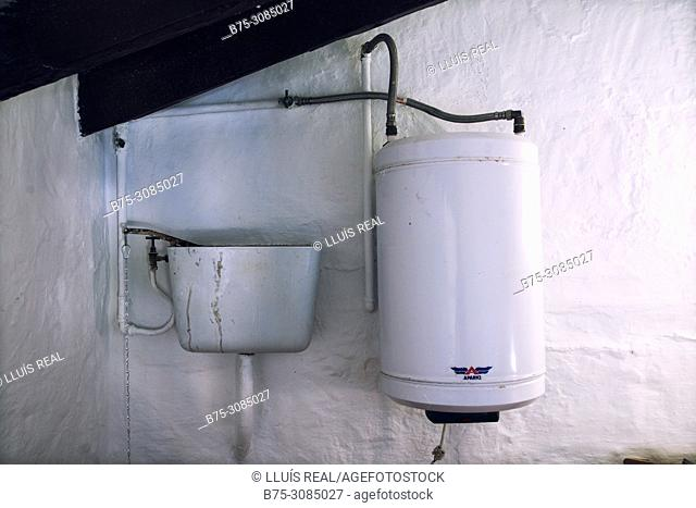 Close up of the cistern WC and boiler in a bathroom. Mahon, Menorca, Baleares, Spain