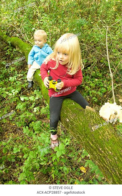 Two children on a nature hike discover something amazing, Woodstock, Ontario, Canada