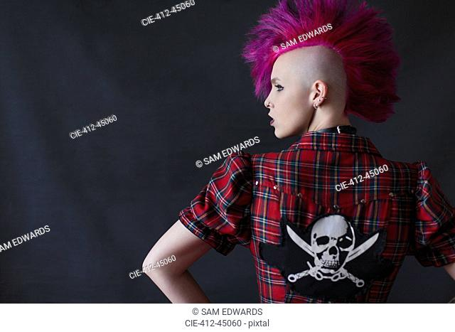 Confident, cool young woman with pink mohawk