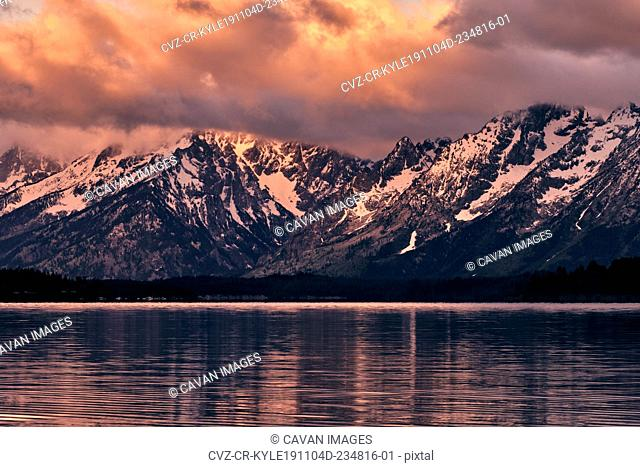 The view of the Grand Tetons overlooking Jackson Lake in the summer