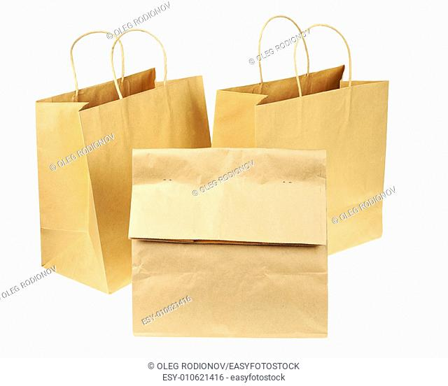 Empty brown recycled paper shopping bags isolated on white background. Side view from top