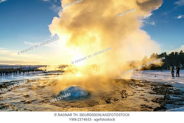 Strokkur is a fountain geyser in the geothermal area beside the Hvita River in the Haukadalur valley, erupting about every 10 minutes or so