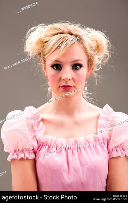 blonde woman with a pale pink dress