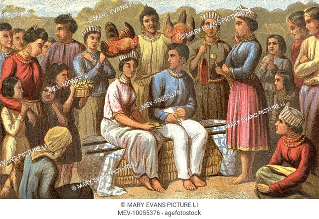 Marriage custom of the Lundu people of the East Indies - the happy couple sit while friends and neighbours bring useful presents