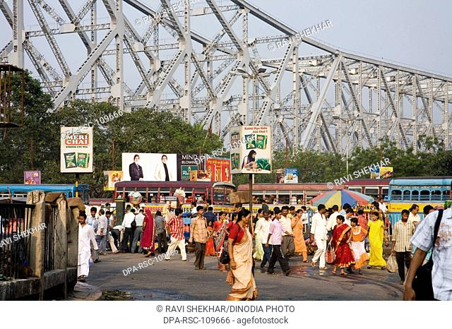 Street Scene ; Howrah Bridge now Rabindra Setu over River Hooghly ; Calcutta Kolkata ; West Bengal ; India