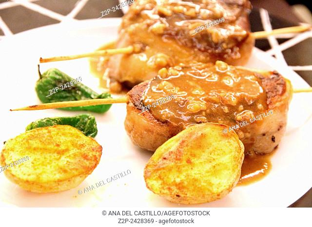 Lamb meat with roasted potatoes on plate Spain