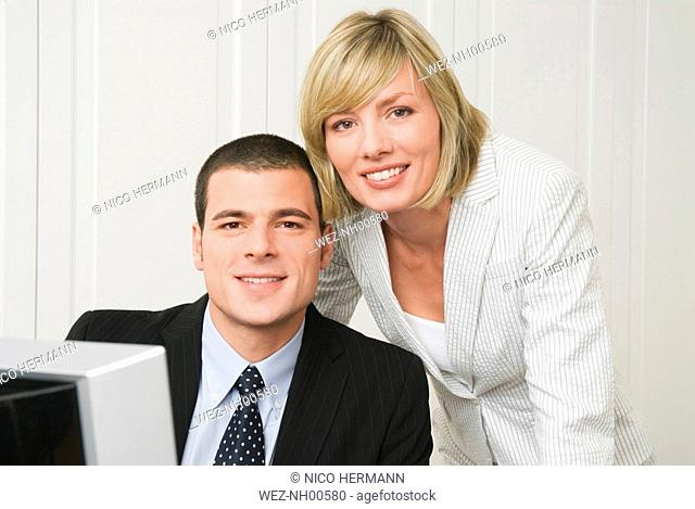 Business people in office, close-up, portrait