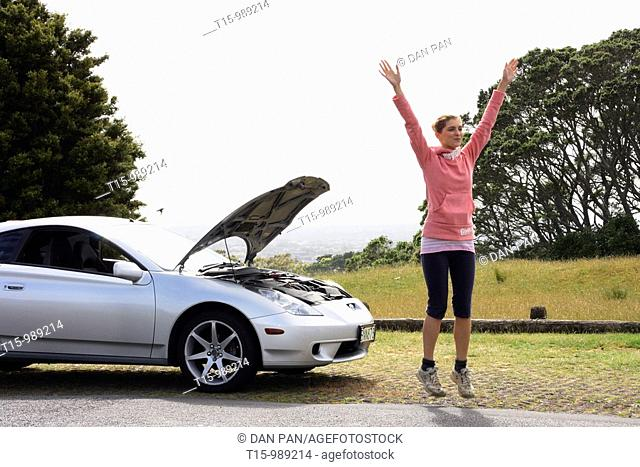 A female hitchhiker with car problem