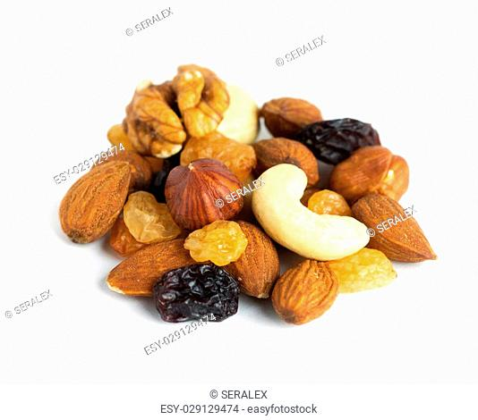 Healthy dried fruits and nuts on white background