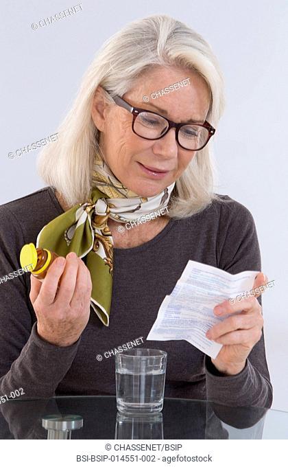 Senior woman taking a supplement