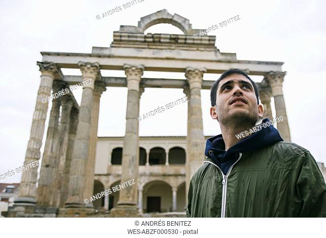 Spain, Merida, portrait of man in front of Roman ruins