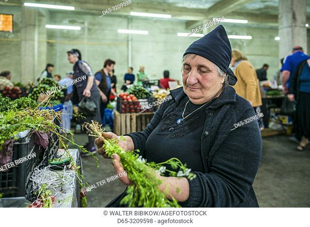 Georgia, Kutaisi, Kutaisi Market, produce vendor, NR