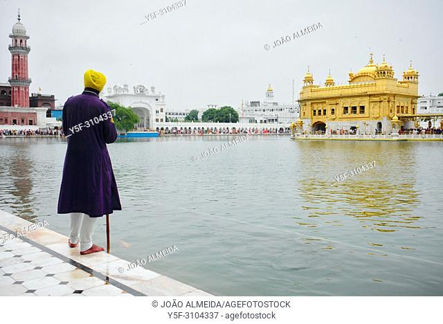 Guard men at the Golden Temple, monitoring visitors and ensuring sacred nature of the site