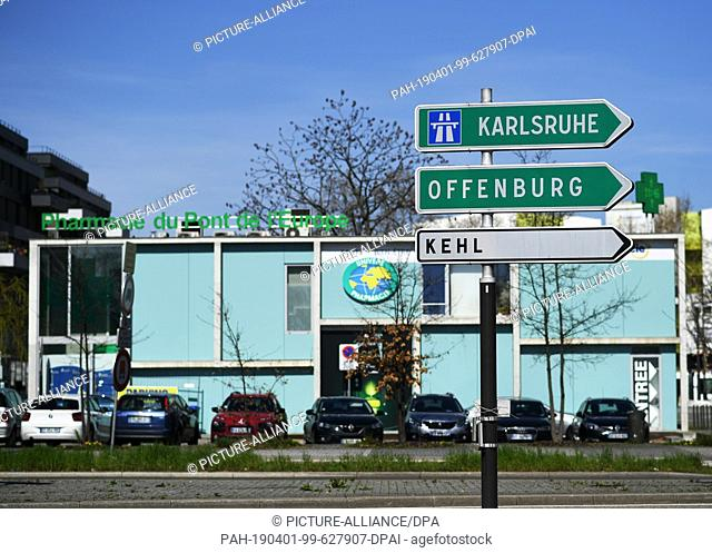 28 March 2019, France (France), Straßburg: Directional signs to Karlsruhe, Offenburg and Kehl are located in the Neudorf district in front of the Europabrücken...